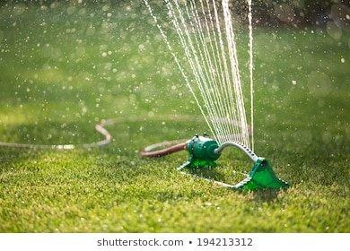 lawn-sprinkler-spaying-water-over-260nw-194213312.jpg